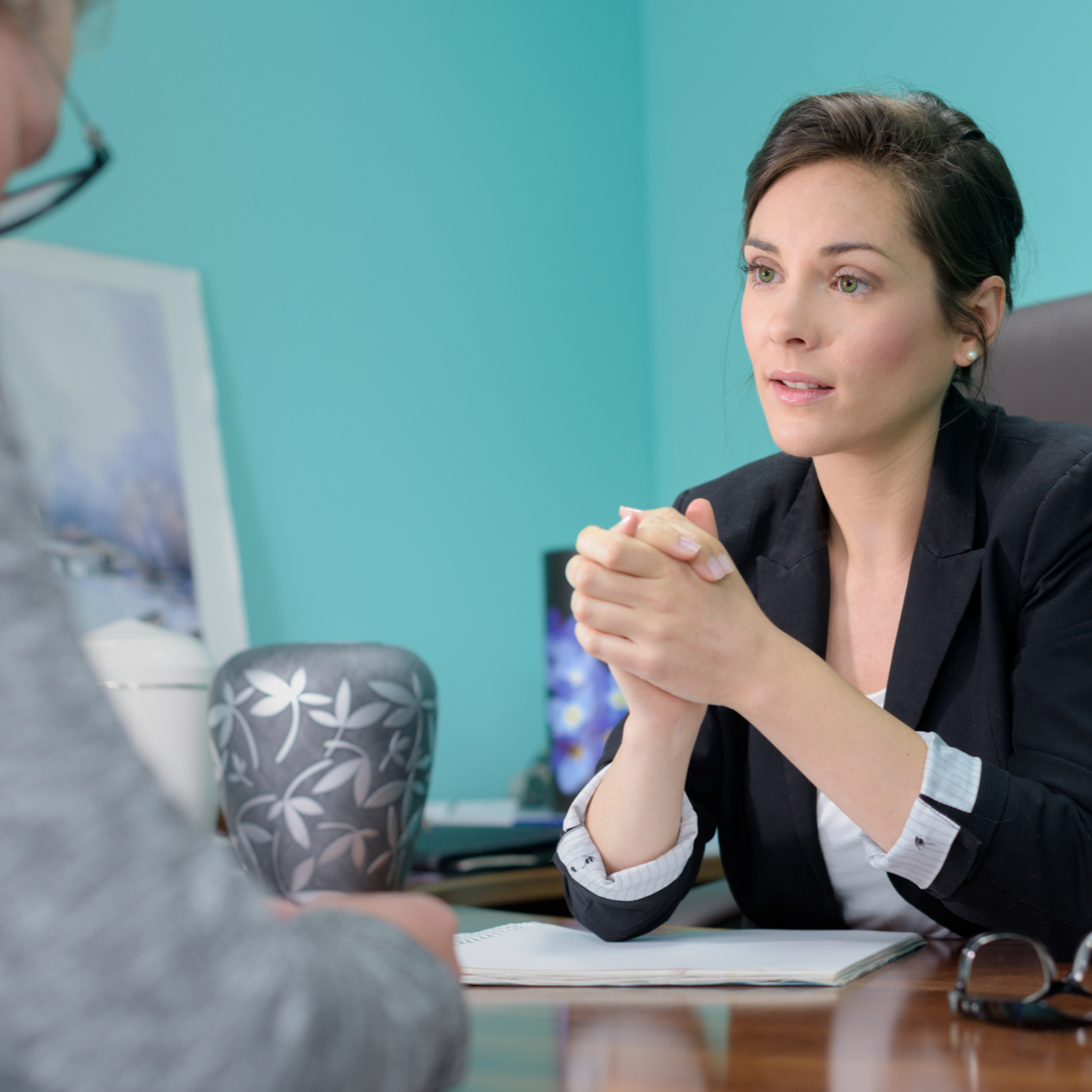 Sympathetic funeral team member in meeting with client in her office